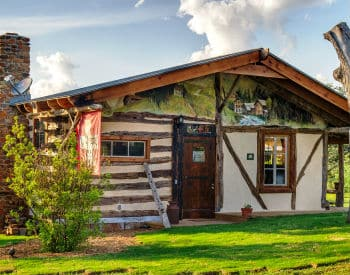Davos Soaring Vaulted Ceilings, Majestic Stained Glass Windows, And A  Spacious Custom Kitchenette Welcome You To This Colorful Open Concept Cabin.